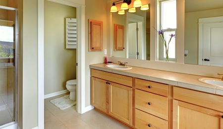 Large classic beautiful bathroom with double sink and shower.